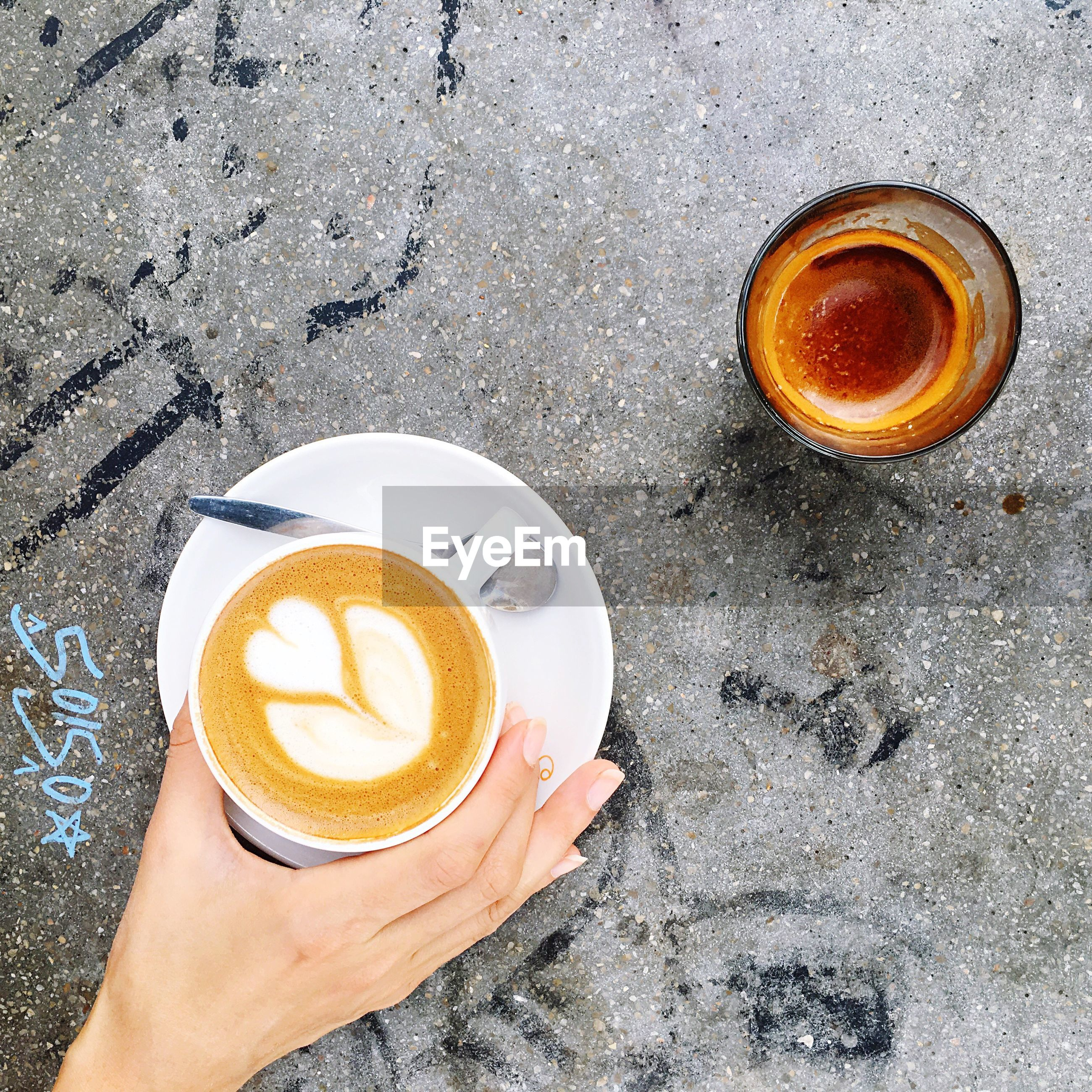 drink, food and drink, refreshment, human hand, coffee - drink, coffee cup, directly above, human body part, one person, frothy drink, high angle view, real people, holding, saucer, drinking glass, freshness, froth art, close-up, cappuccino, alcohol, outdoors, day, food, people