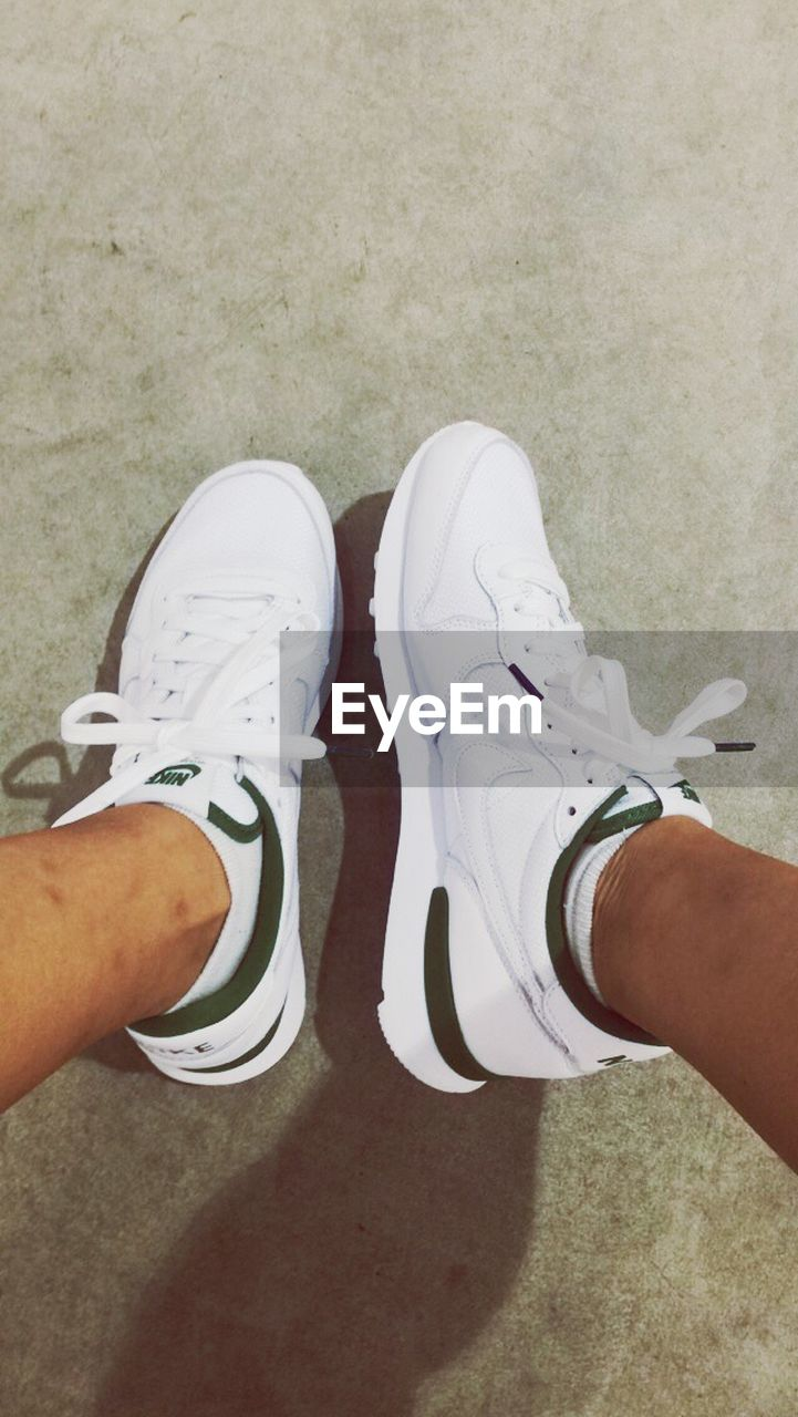 human body part, human leg, real people, low section, men, two people, human foot, leisure activity, shoe, high angle view, human hand, lifestyles, day, togetherness, standing, women, outdoors, childhood, close-up, people