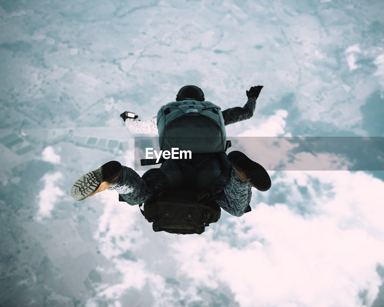 Full Length Of Man With Backpack Skydiving In Sky