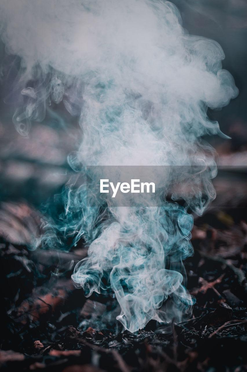 Close-Up Of Smoke Emitting Form Burned Plants