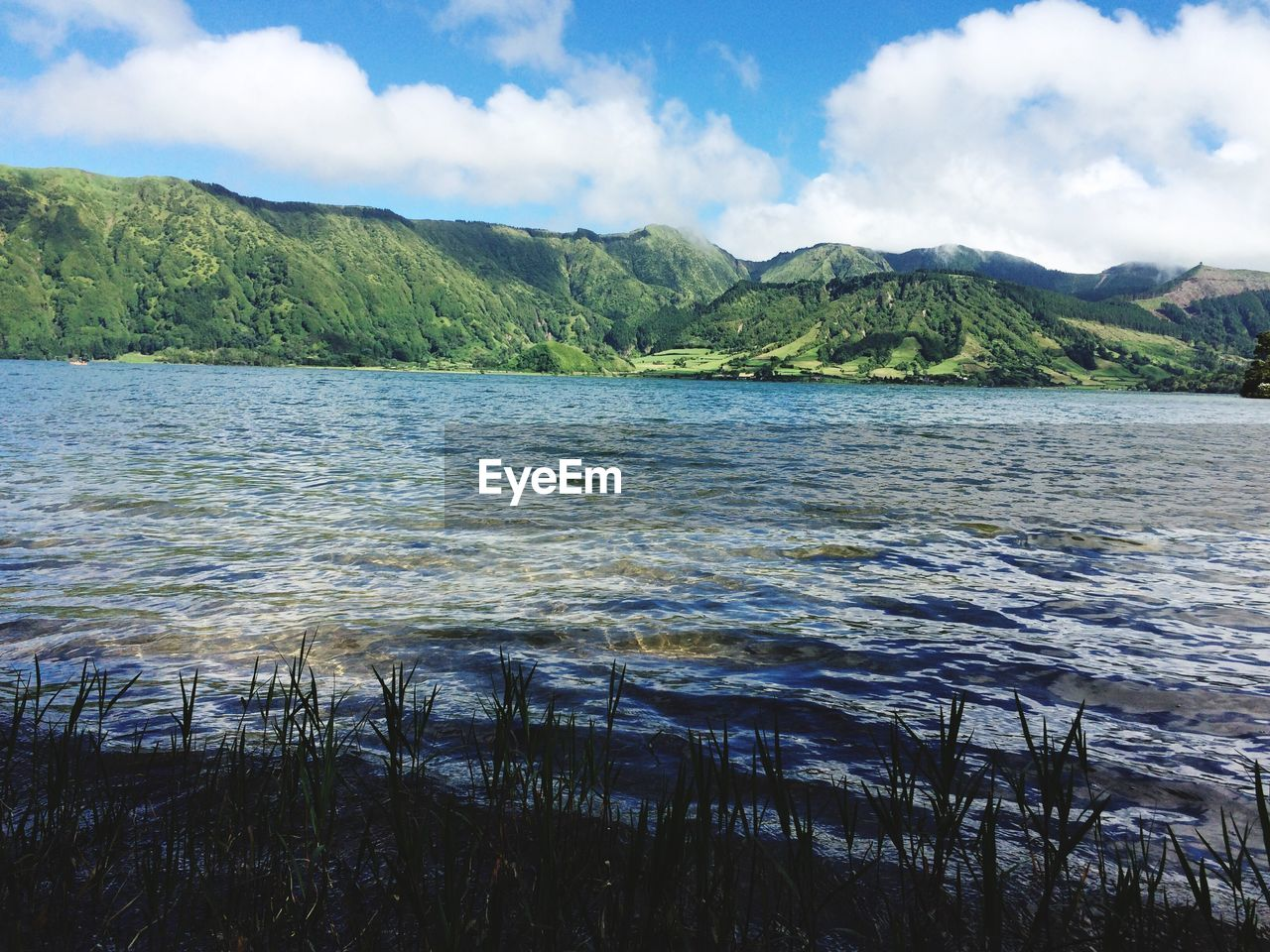 Scenic view of lagoa das sete cidades against sky