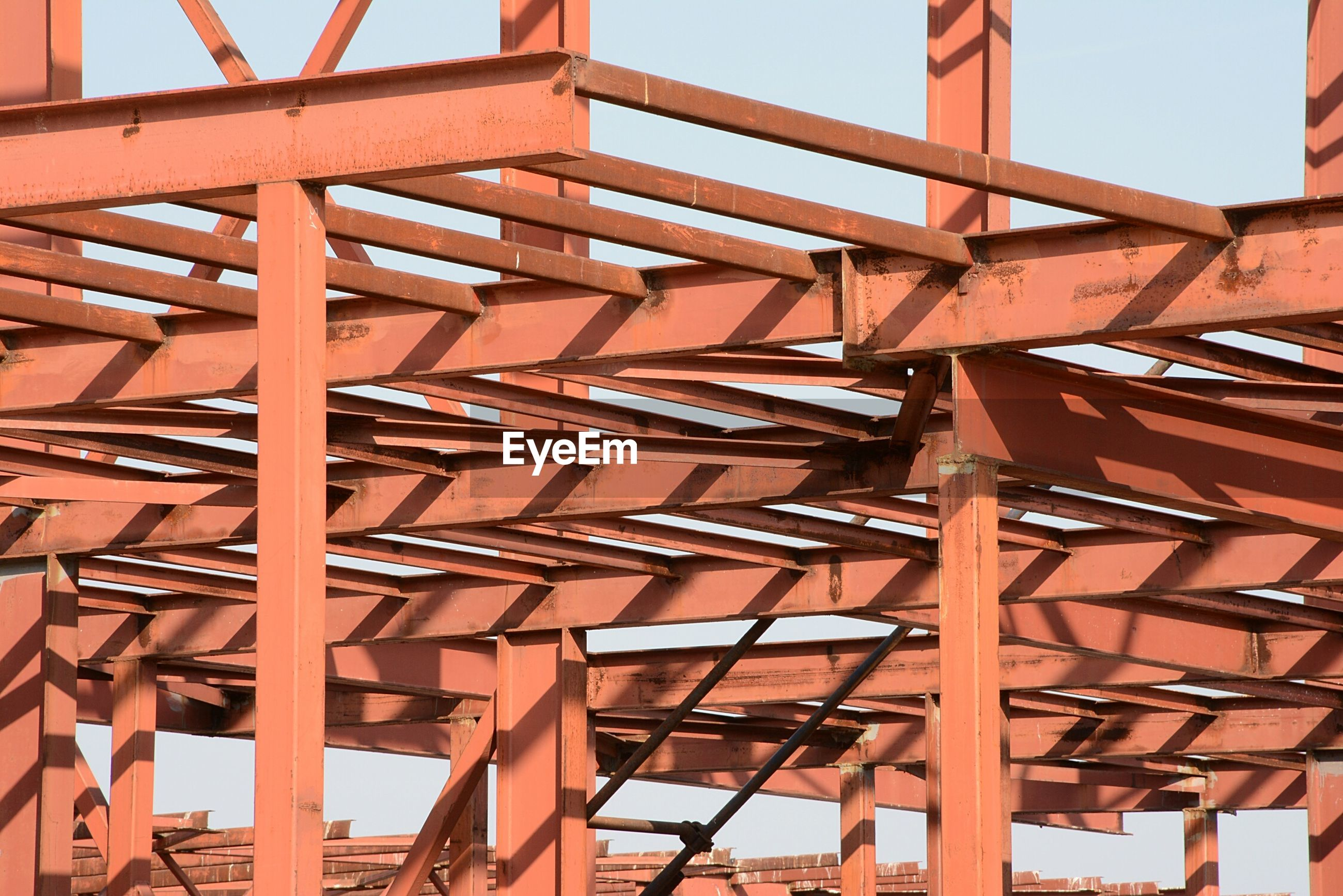 Low angle view of steel structure against sky, steel beams