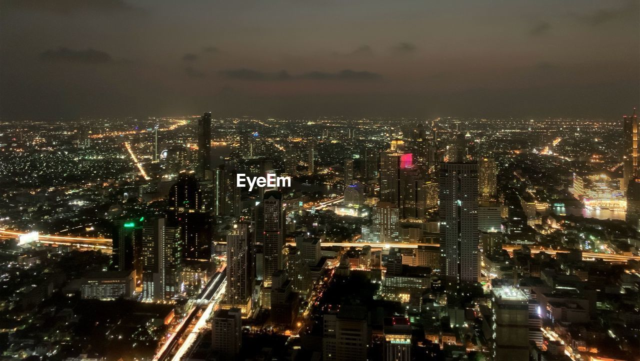 city, illuminated, cityscape, building exterior, architecture, night, built structure, sky, crowd, building, residential district, high angle view, crowded, modern, nature, office building exterior, cloud - sky, skyscraper, city life, outdoors, light, financial district