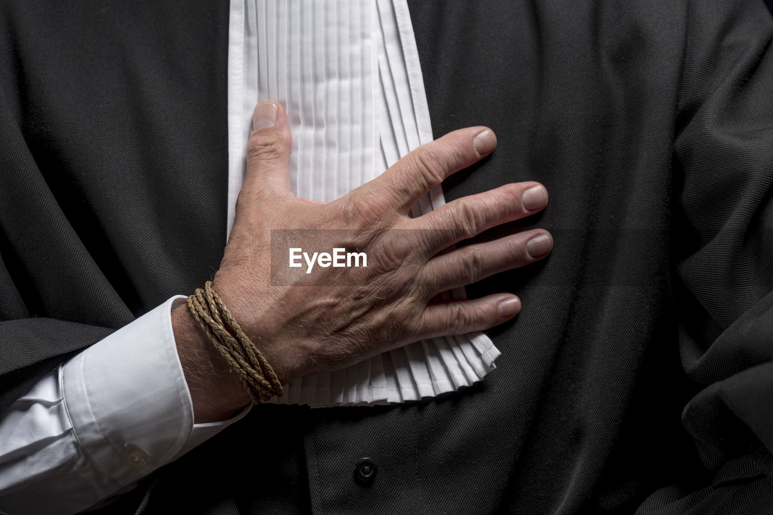 Midsection of lawyer against black background