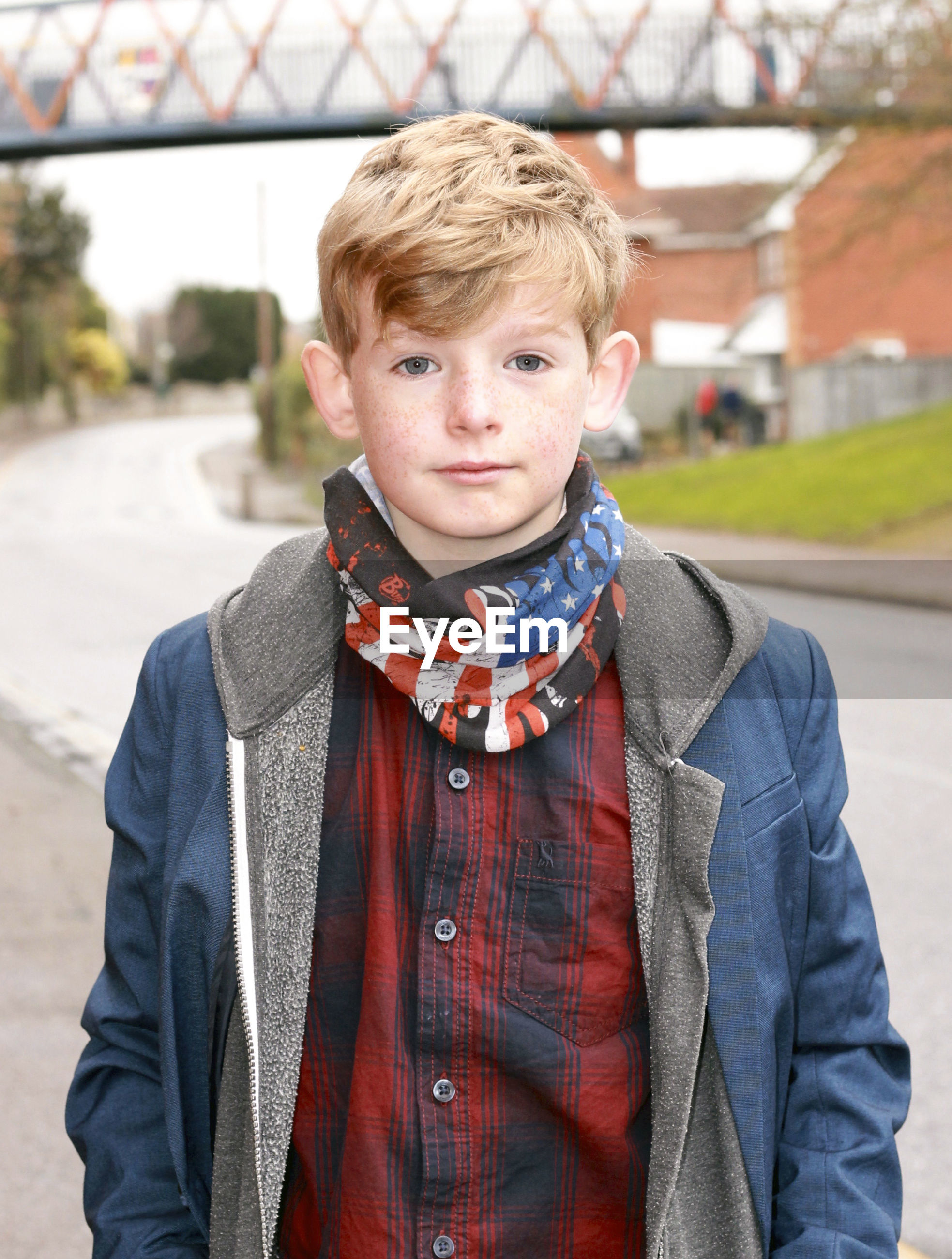 Portrait of boy standing on road