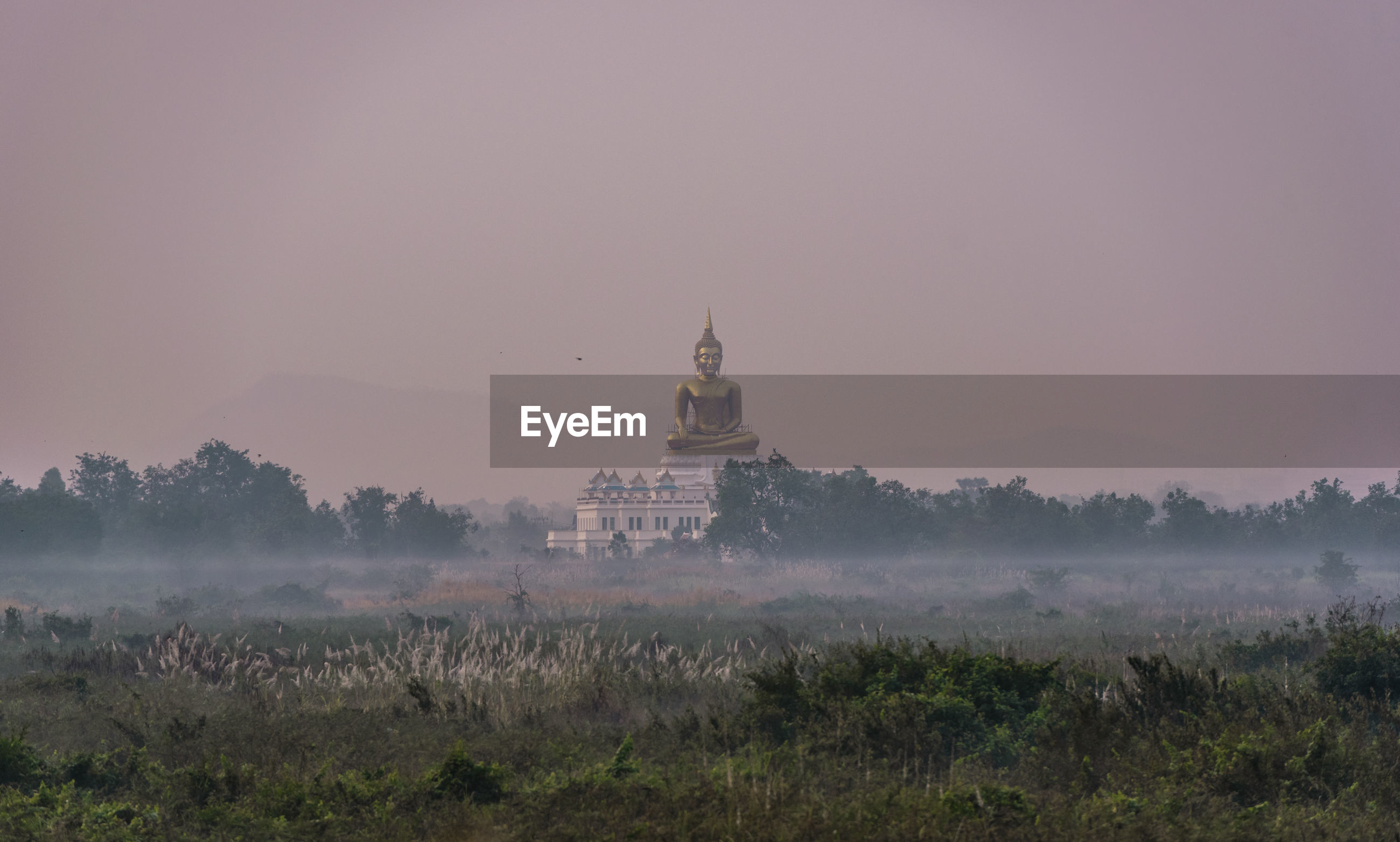 View of building against sky during foggy weather