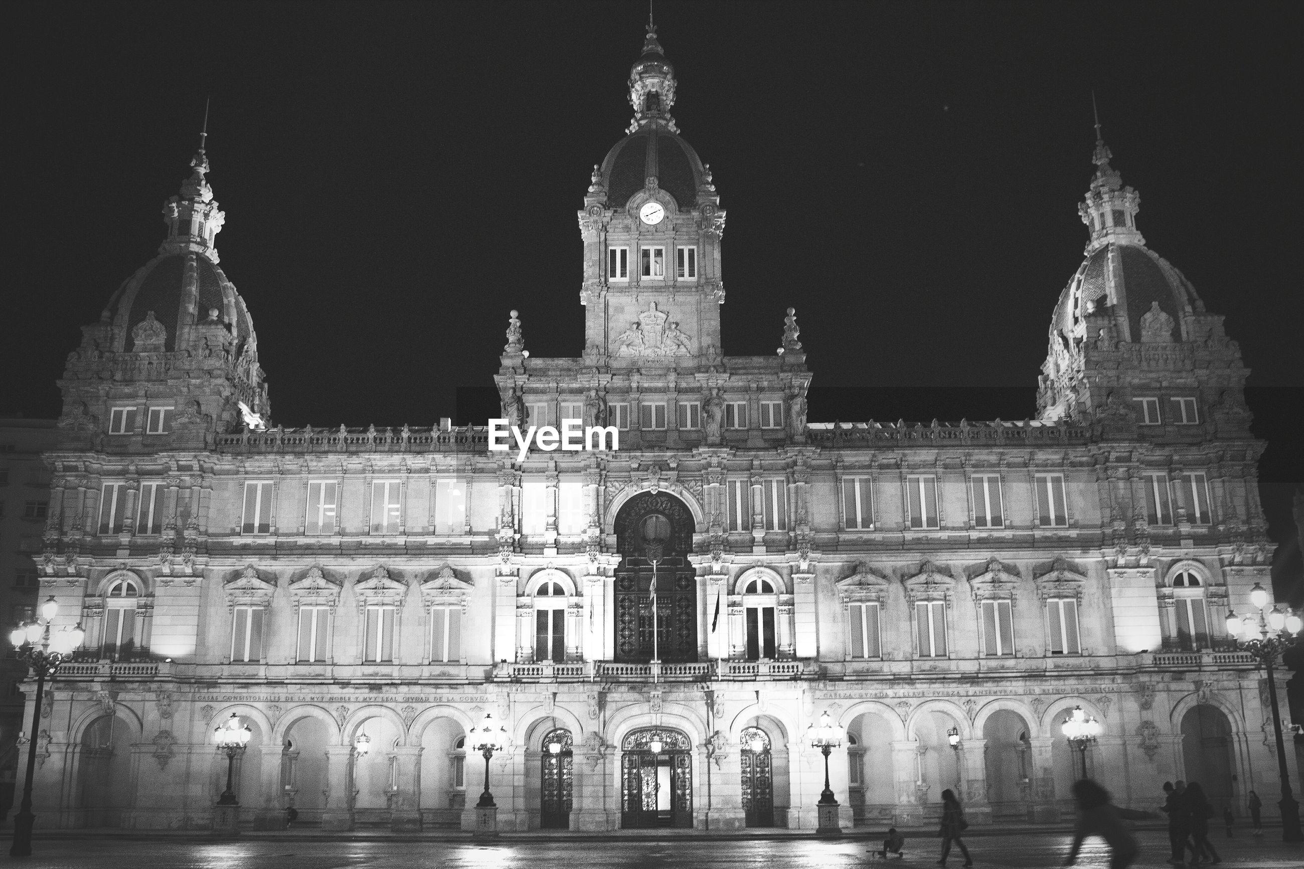 Facade of ayuntamiento de a coruna against sky at night