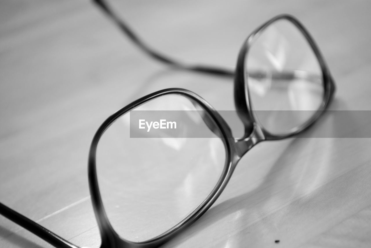 Close-Up Of Eyeglasses On Wooden Table