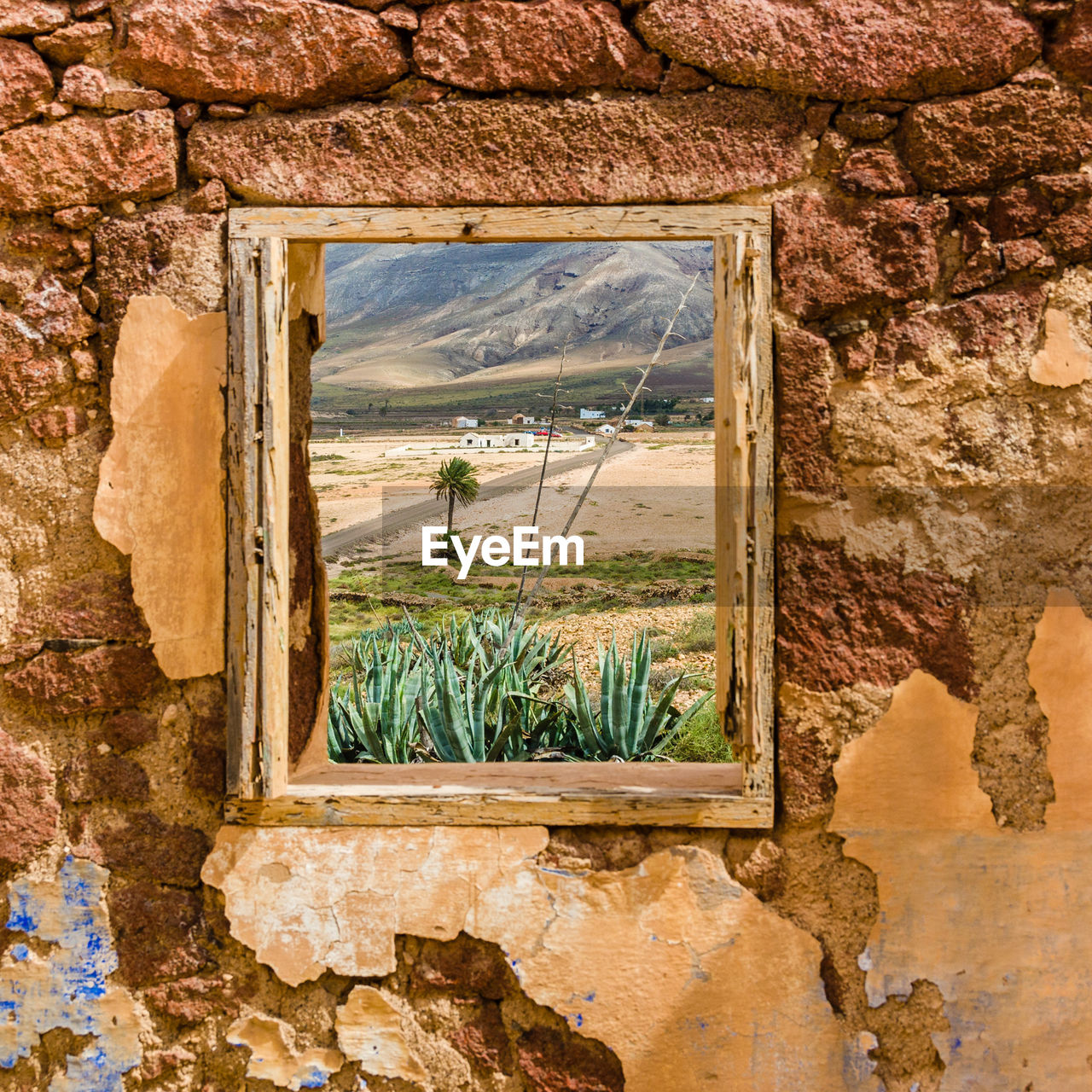 Landscape and mountain seen through abandoned house window