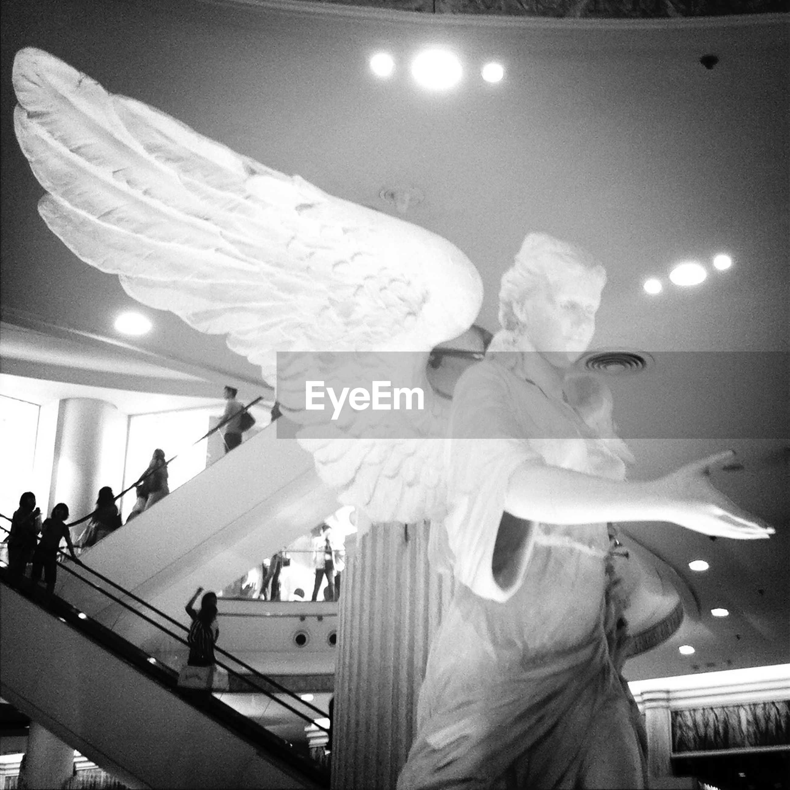 Low angle view of angel statue in building