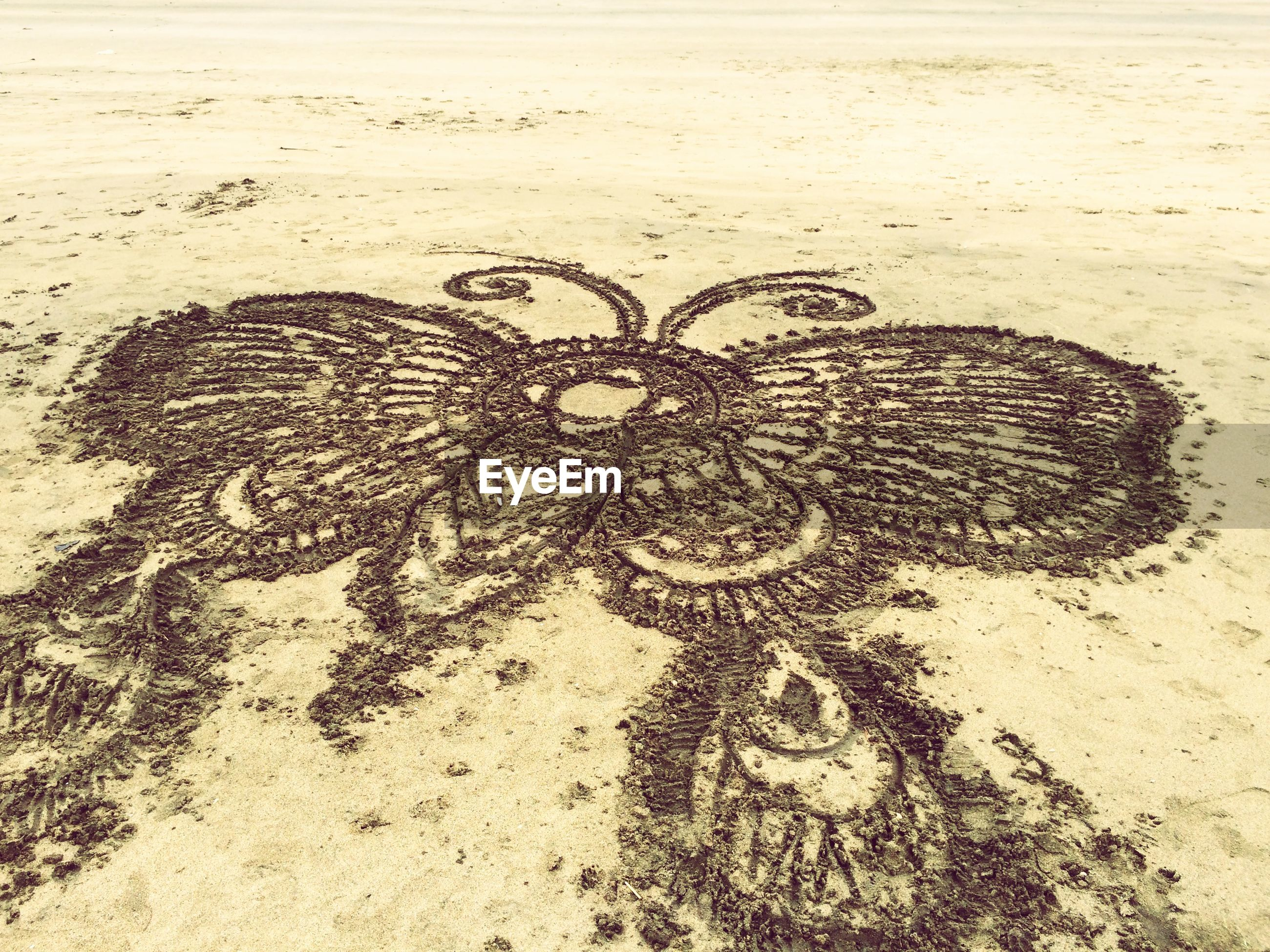 High angle view of drawing on sand in beach