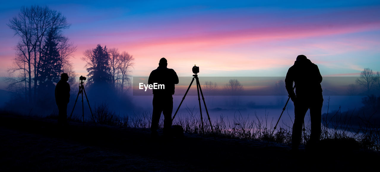 silhouette, sky, tripod, standing, sunset, men, real people, photography themes, camera - photographic equipment, nature, technology, beauty in nature, occupation, land, photographing, photographer, people, leisure activity, scenics - nature, full length, outdoors, digital camera