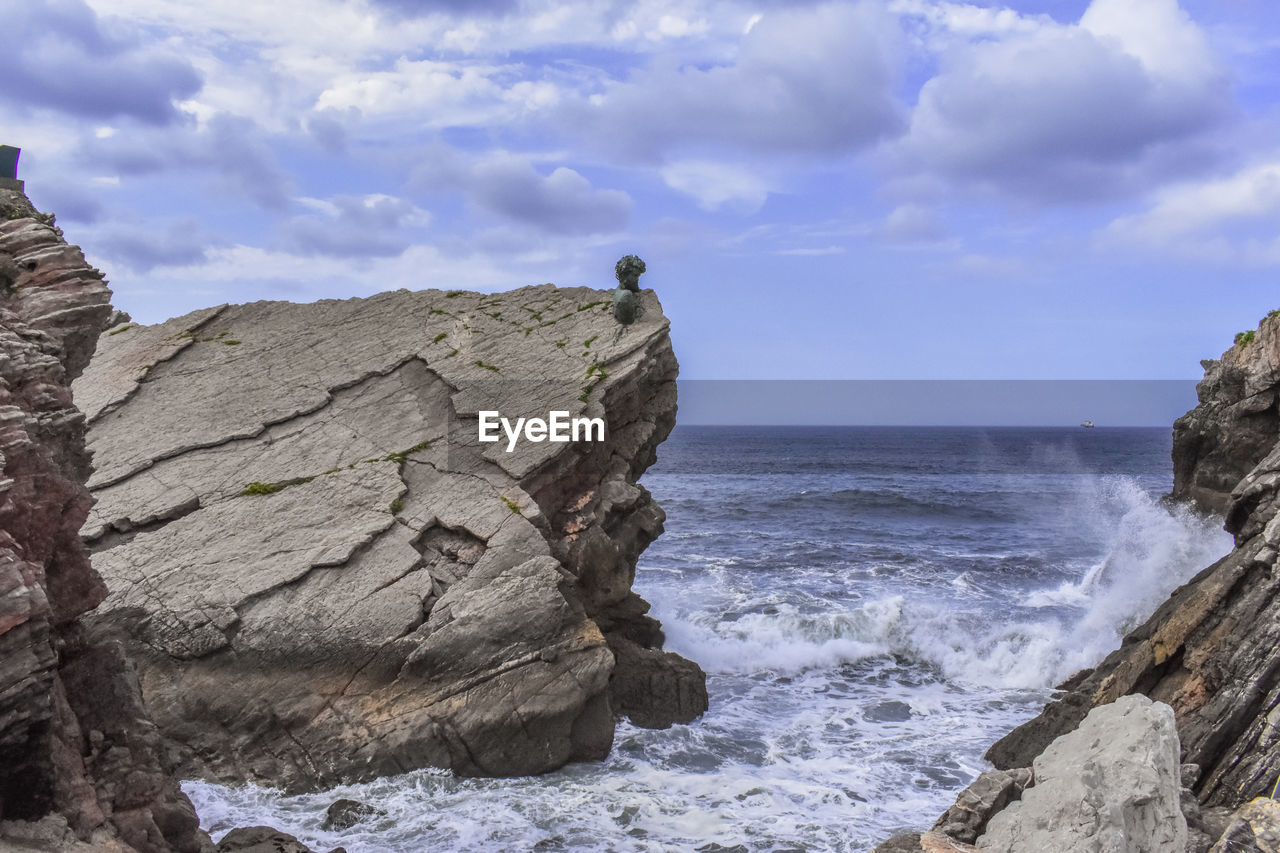 sea, rock, water, sky, solid, rock - object, beauty in nature, rock formation, cloud - sky, scenics - nature, land, nature, motion, tranquil scene, day, beach, horizon, horizon over water, cliff, no people, outdoors, eroded, formation