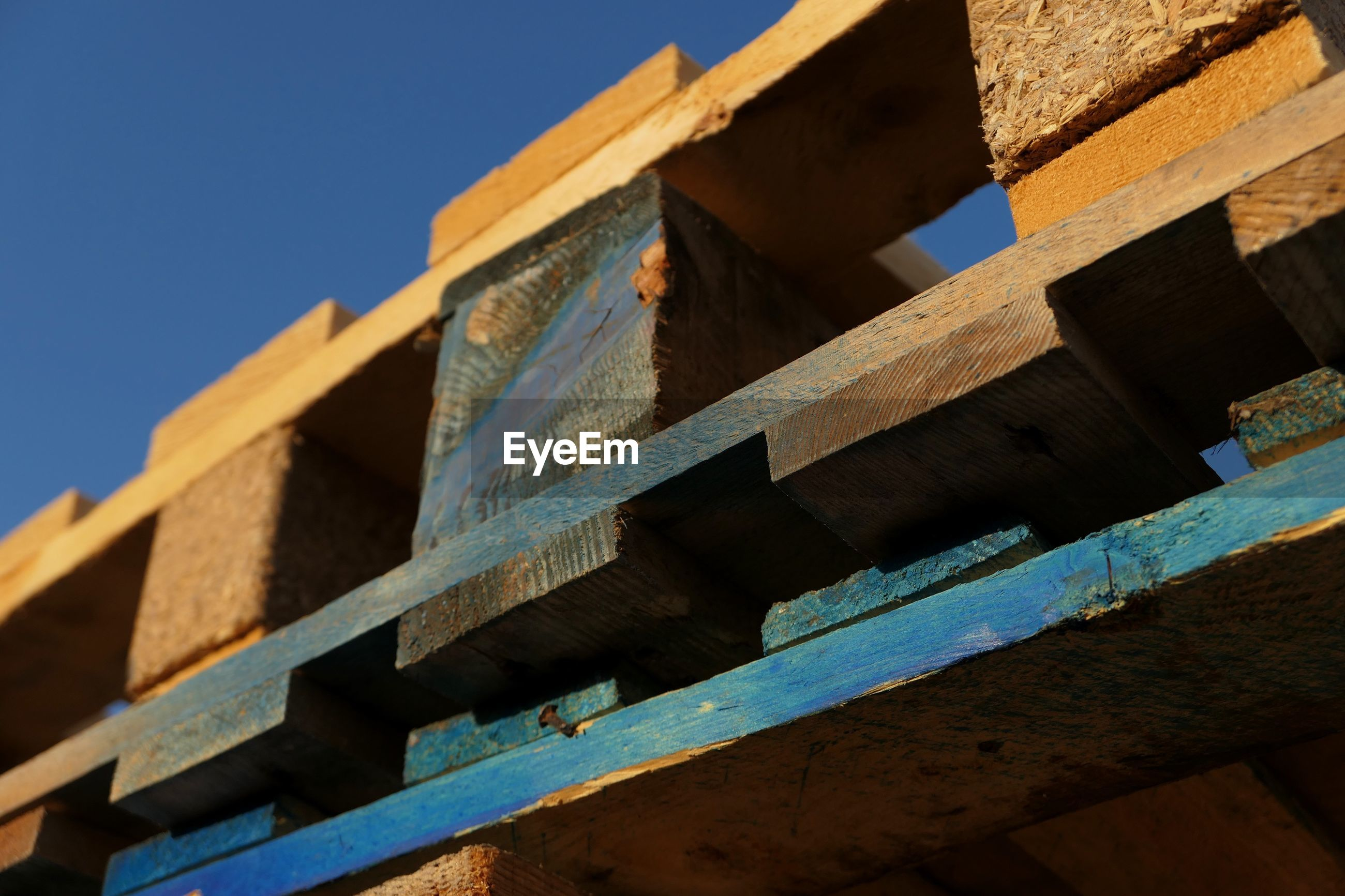 Low angle view of wooden pallets