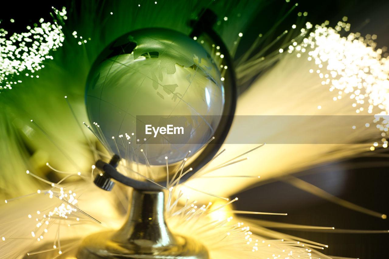 CLOSE-UP OF ILLUMINATED LIGHTING EQUIPMENT IN METAL