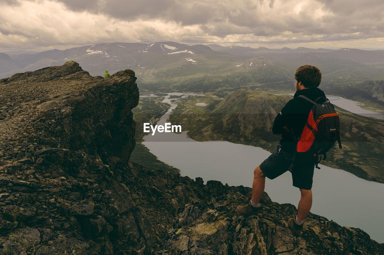 FULL LENGTH OF MAN ON MOUNTAIN