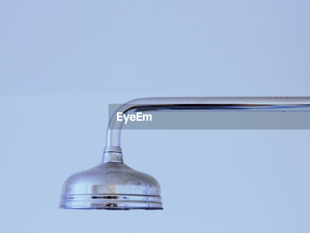 Close-up of shower head against white background