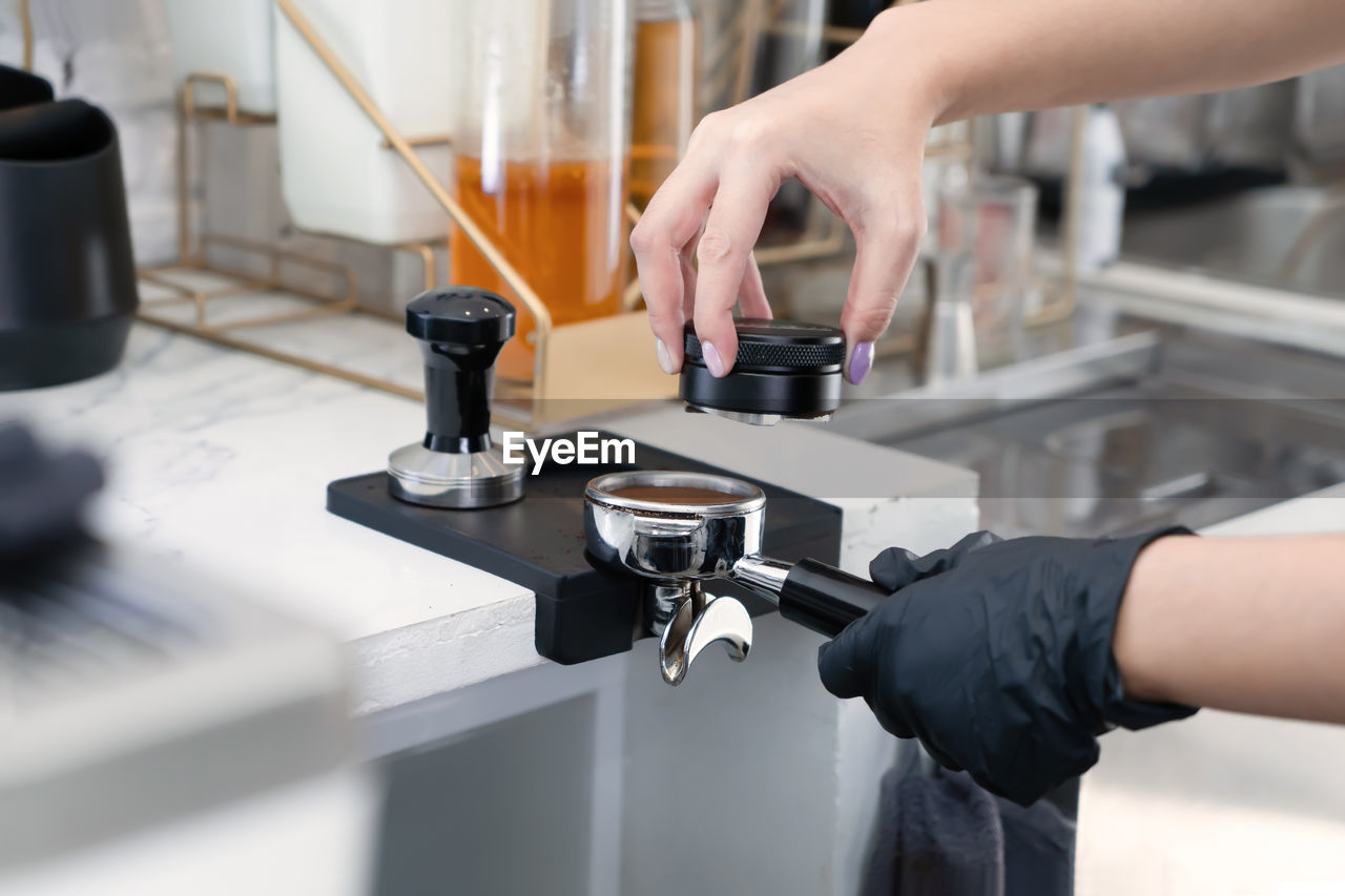 Barista make a coffee with coffee maker at cafe