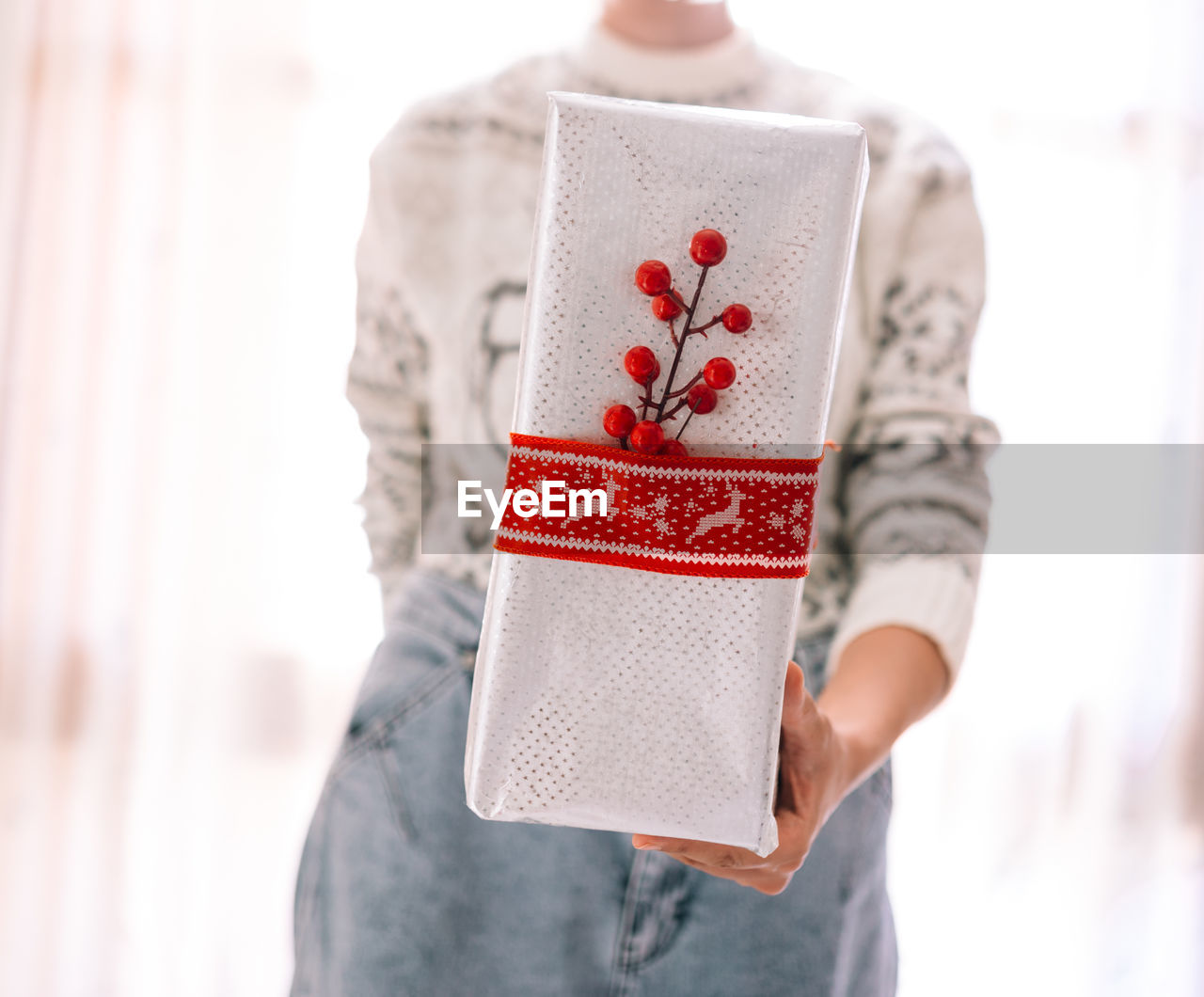 Midsection of woman holding christmas gift