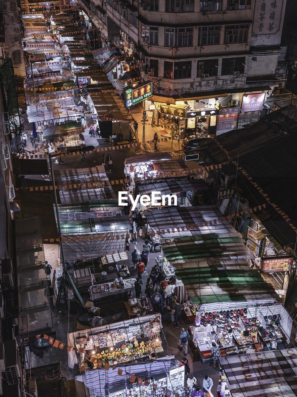 High angle view of illuminated street market at night
