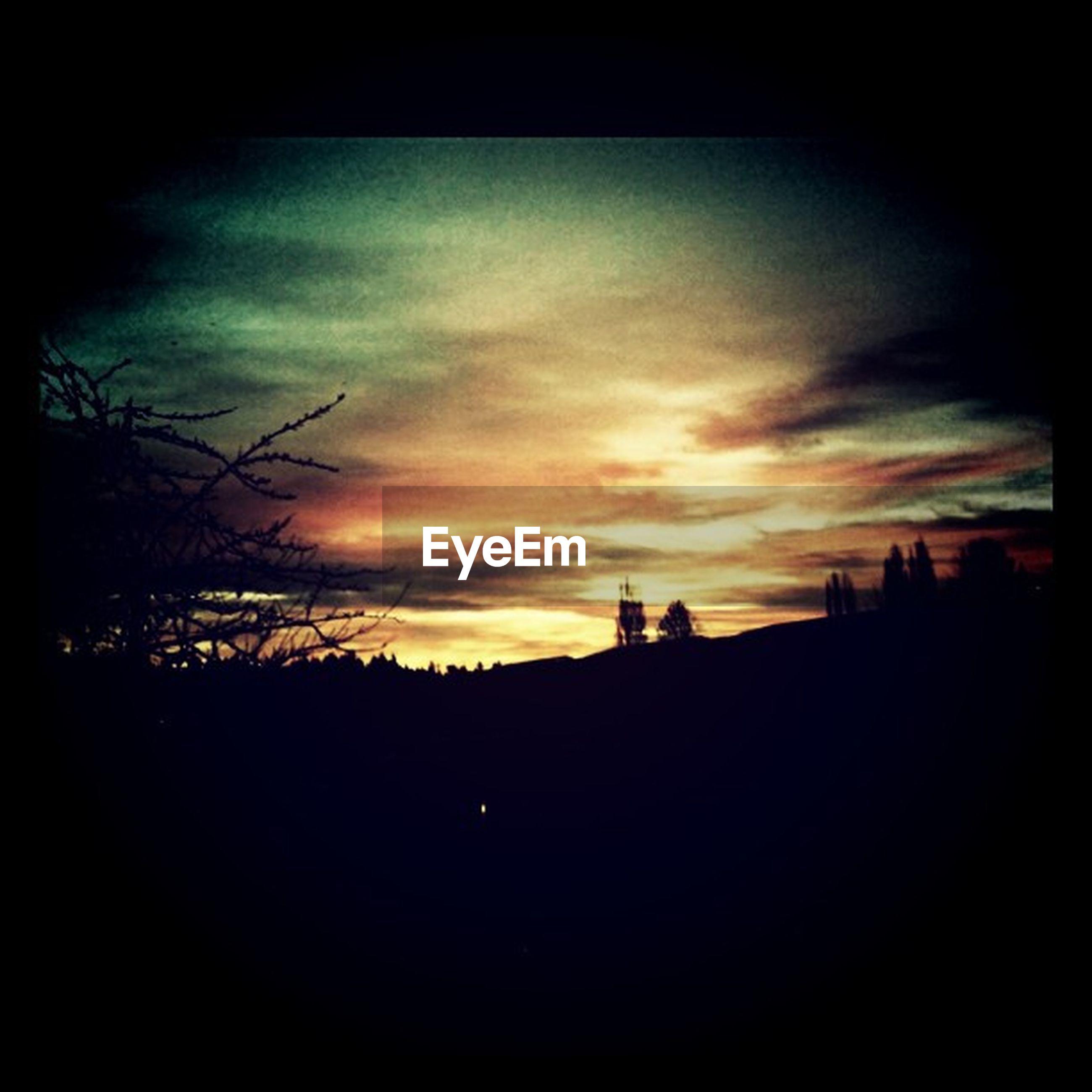 silhouette, sunset, sky, dark, built structure, architecture, tree, scenics, building exterior, cloud - sky, beauty in nature, orange color, tranquility, nature, tranquil scene, outline, dusk, cloud, landscape, dramatic sky