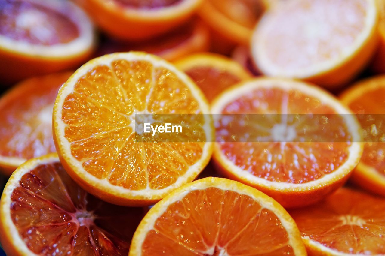 food, healthy eating, food and drink, orange color, fruit, wellbeing, freshness, citrus fruit, cross section, slice, orange - fruit, close-up, still life, orange, no people, indoors, juicy, focus on foreground, group of objects, halved, ripe