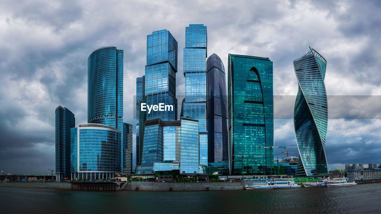 built structure, building exterior, architecture, office building exterior, city, modern, building, skyscraper, sky, cloud - sky, water, office, waterfront, nature, tall - high, tower, landscape, no people, urban skyline, outdoors, financial district, cityscape