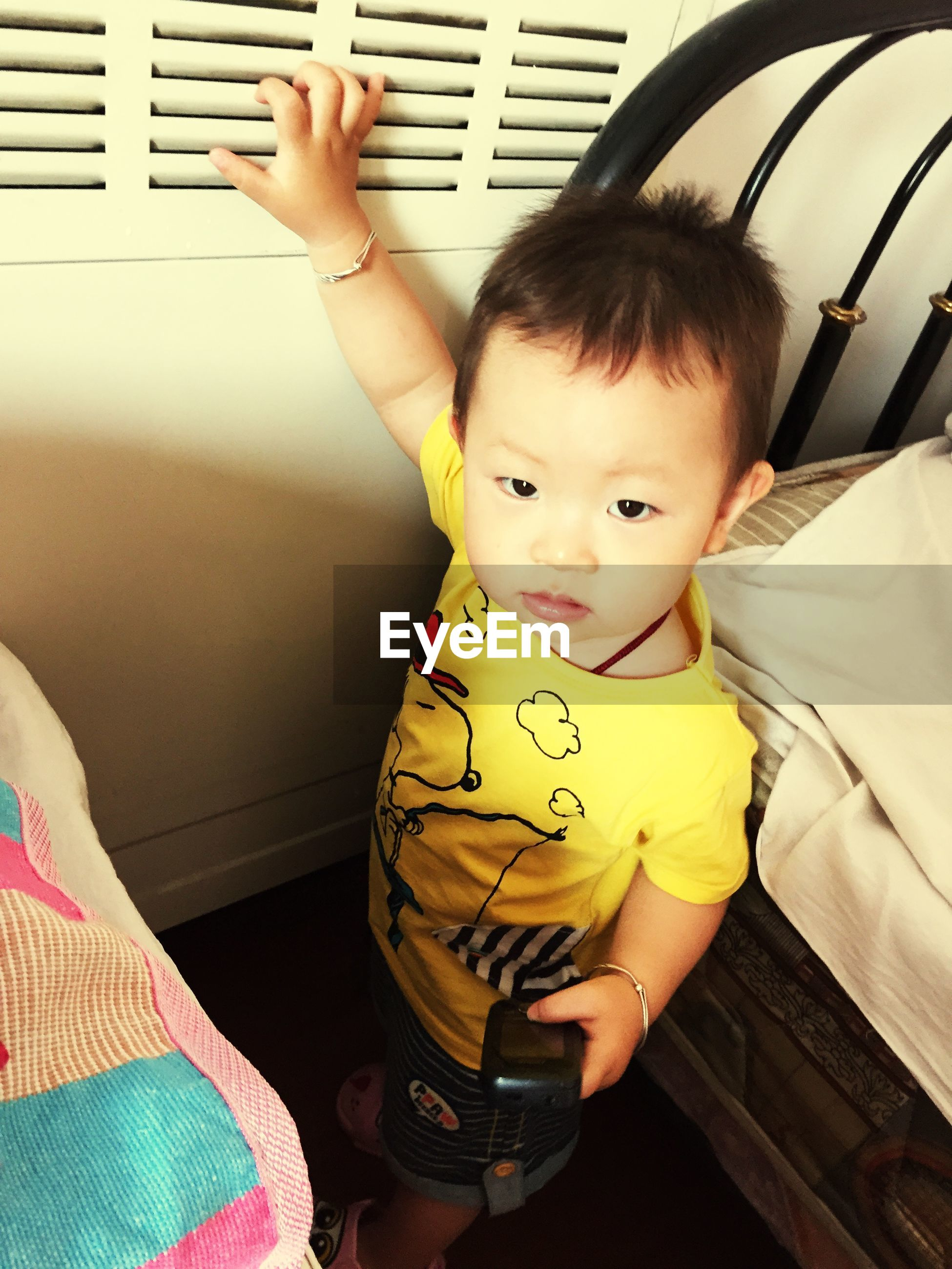 childhood, lifestyles, cute, elementary age, person, indoors, leisure activity, innocence, boys, high angle view, casual clothing, holding, girls, sitting, toddler, looking at camera, three quarter length, baby