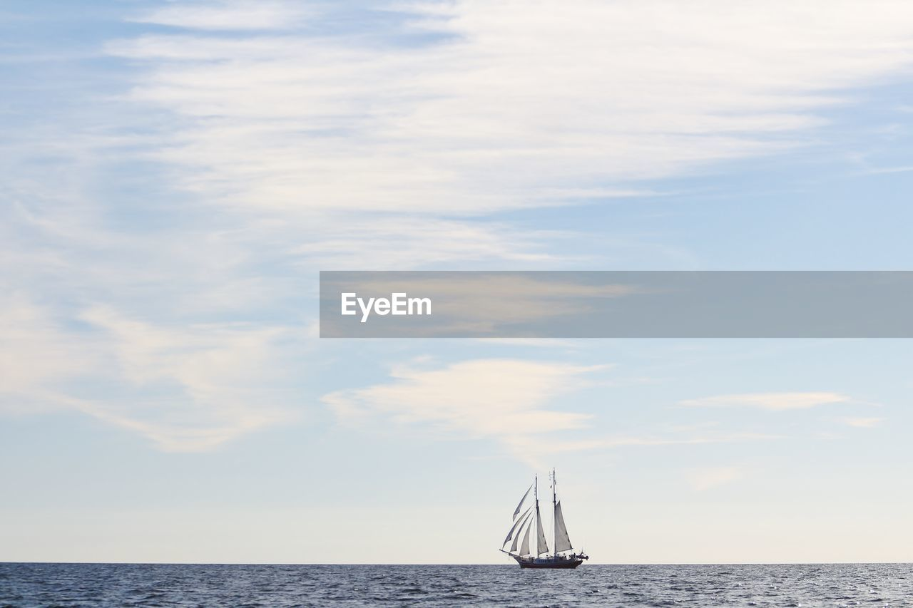 sea, cloud - sky, sky, horizon over water, nautical vessel, water, scenics, sailing, sailboat, transportation, mode of transport, nature, tranquility, outdoors, beauty in nature, day, waterfront, no people, horizon, sailing ship