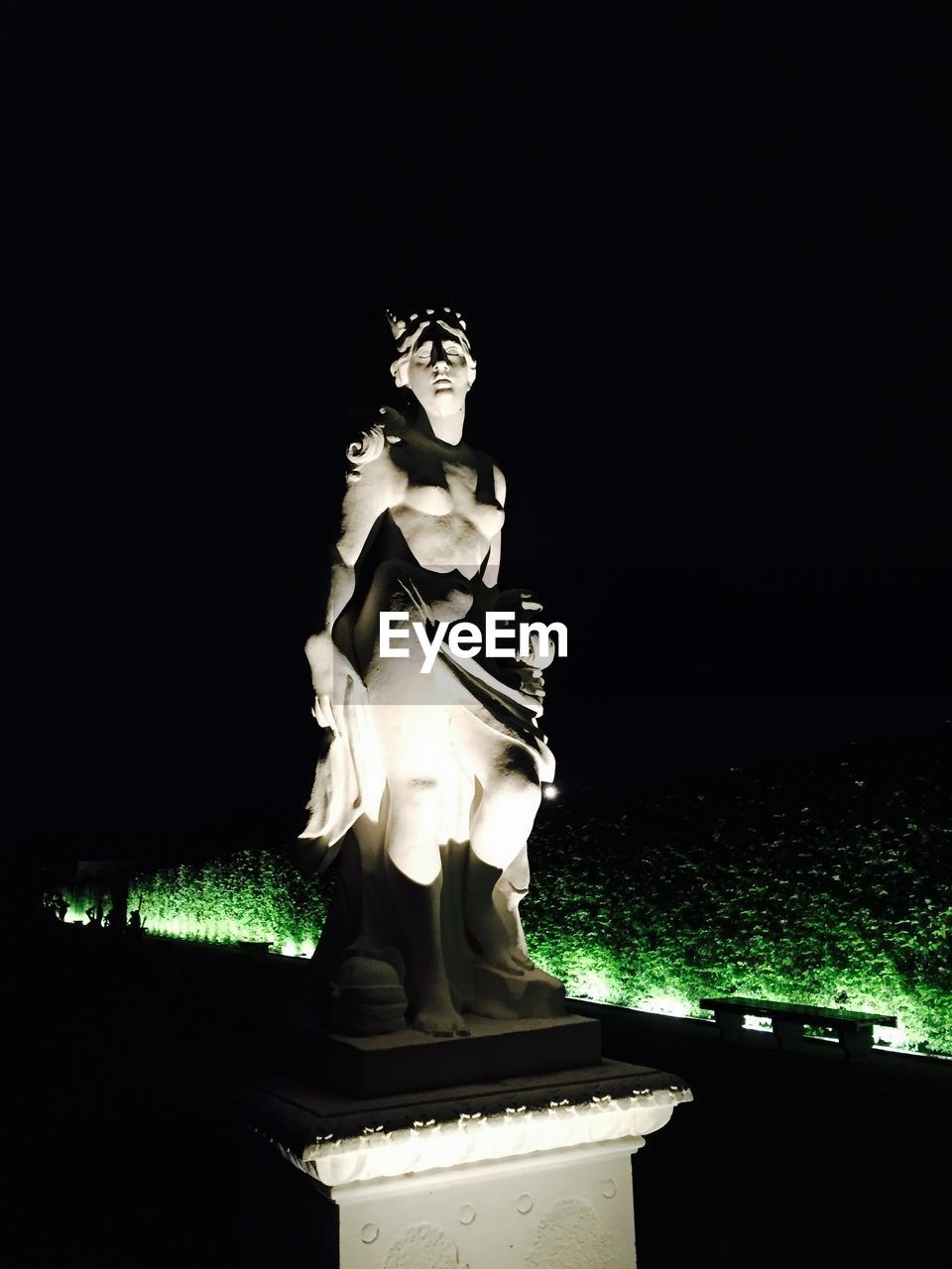 statue, sculpture, night, human representation, art and craft, no people, illuminated, low angle view, outdoors, sky