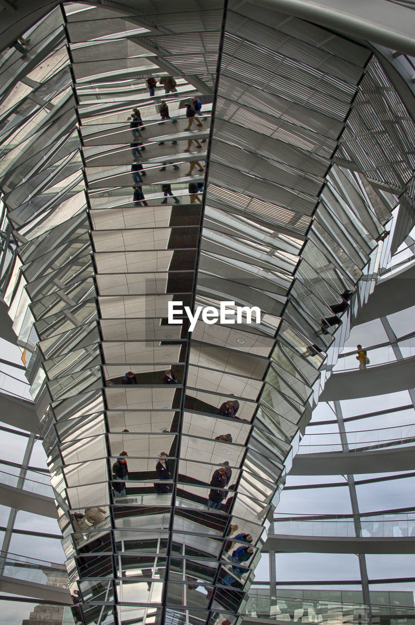 ceiling, indoors, low angle view, architecture, real people, built structure, men, day, people