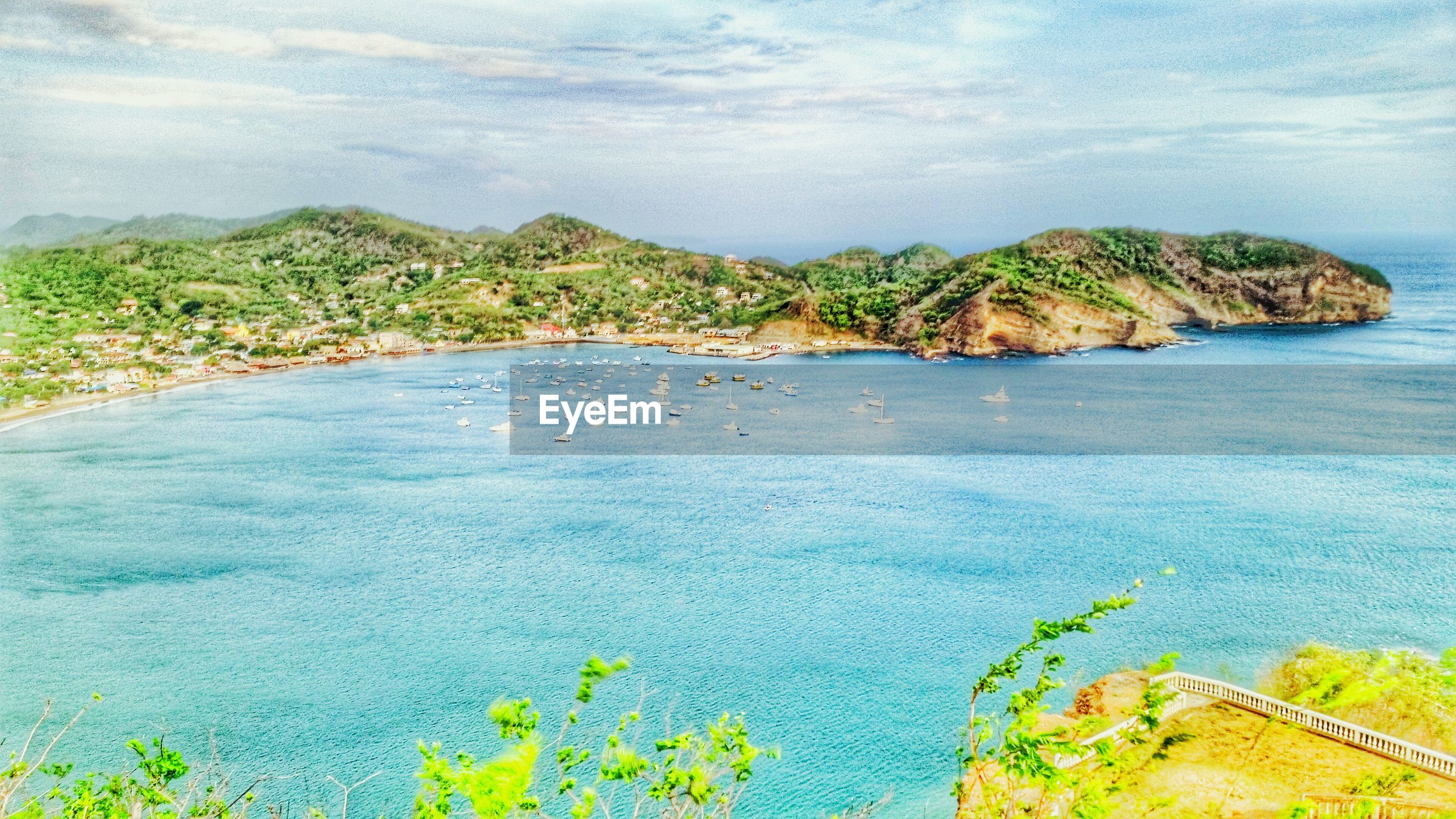 water, sea, tranquil scene, tranquility, scenics, beauty in nature, nature, sky, beach, coastline, plant, shore, green color, horizon over water, idyllic, high angle view, rock - object, growth, day, cliff