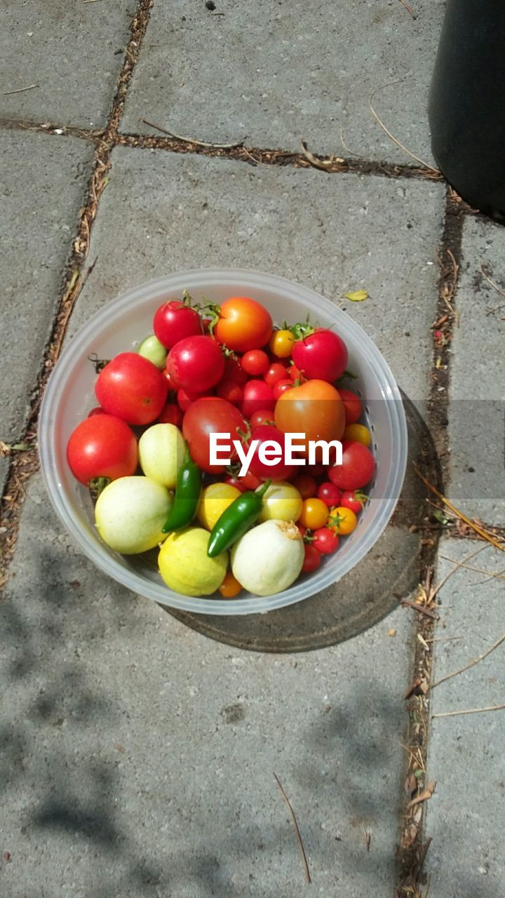 high angle view, food, food and drink, healthy eating, wellbeing, freshness, still life, fruit, red, vegetable, no people, day, container, green color, directly above, tomato, large group of objects, close-up, bowl, choice