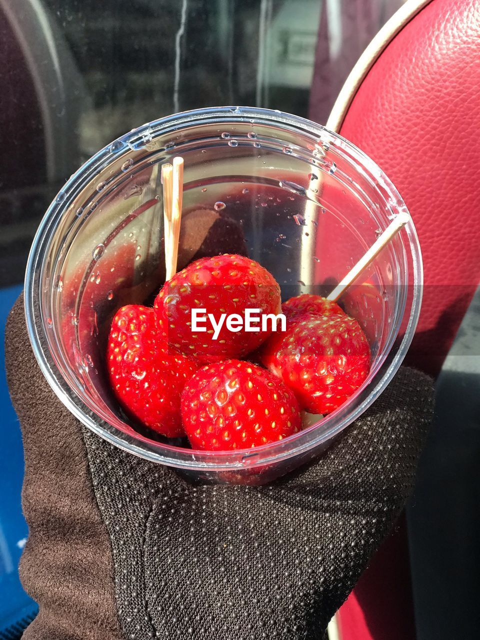 CLOSE-UP OF STRAWBERRIES ON GLASS
