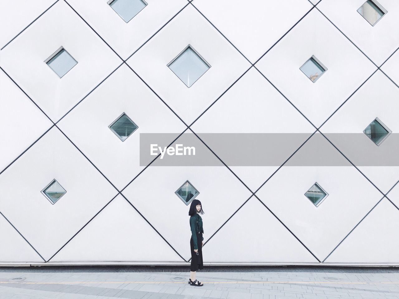 Woman Walking By Modern Building