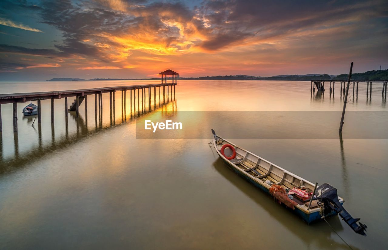 water, sunset, transportation, sky, mode of transportation, cloud - sky, nautical vessel, orange color, beauty in nature, scenics - nature, nature, reflection, waterfront, bridge, built structure, bridge - man made structure, architecture, no people, sea, outdoors