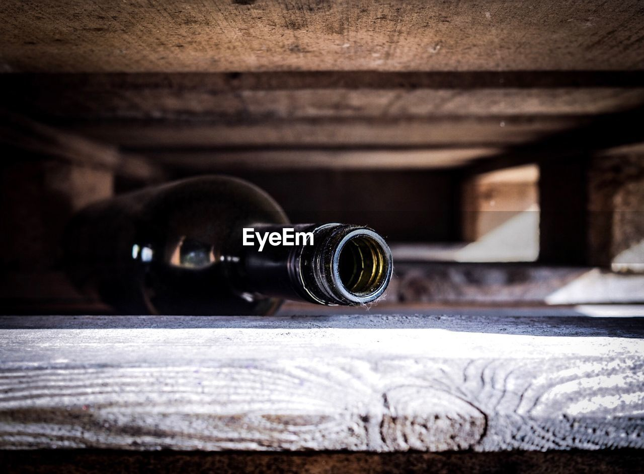 indoors, close-up, no people, wood - material, still life, technology, lens - optical instrument, selective focus, camera, container, photography themes, binoculars, table, day, directly above, camera - photographic equipment, focus on foreground, architecture, equipment