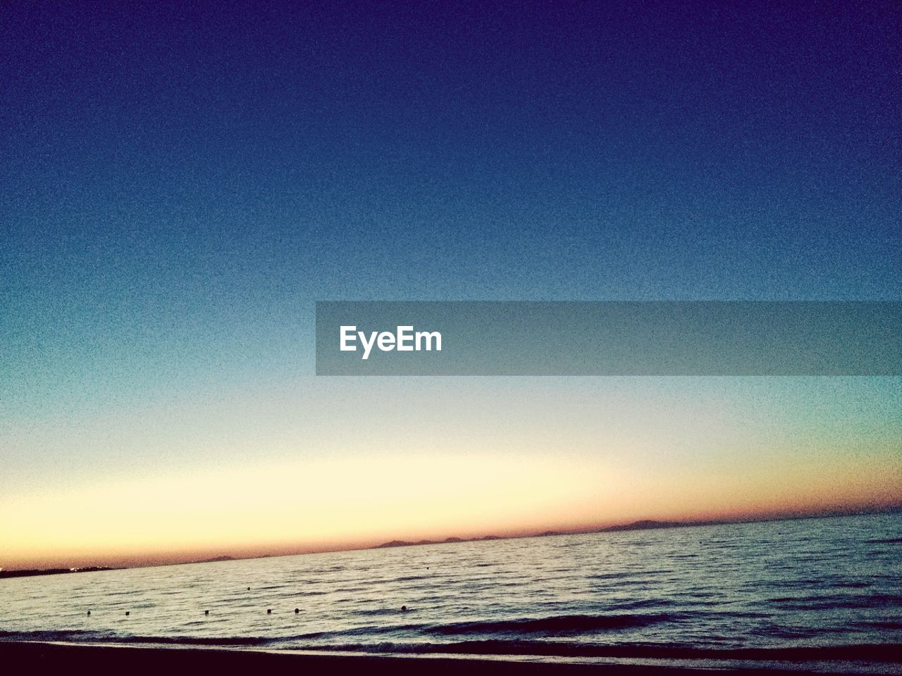 sea, water, sky, scenics - nature, beauty in nature, clear sky, horizon, copy space, tranquil scene, tranquility, horizon over water, blue, nature, land, sunset, beach, outdoors, no people, idyllic