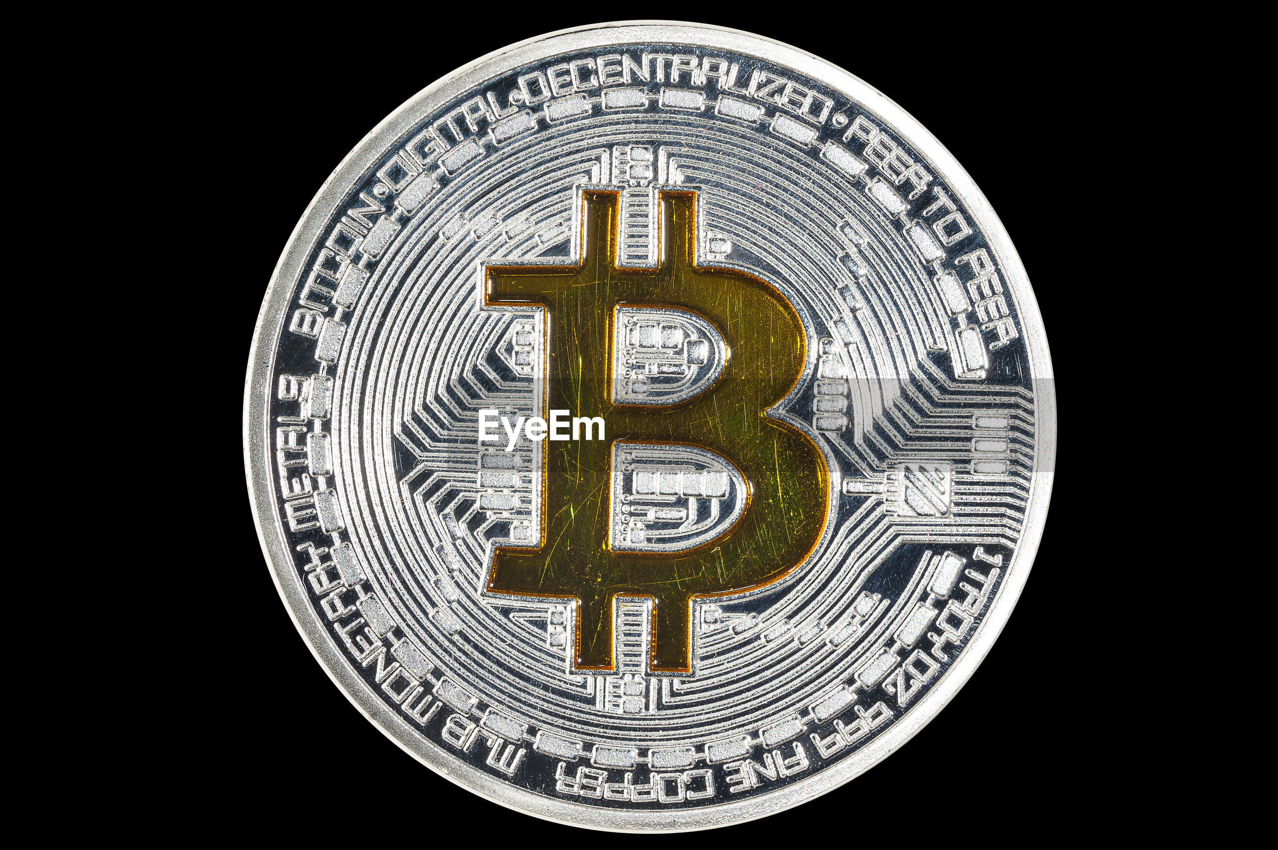 Close-up of bitcoin over black background