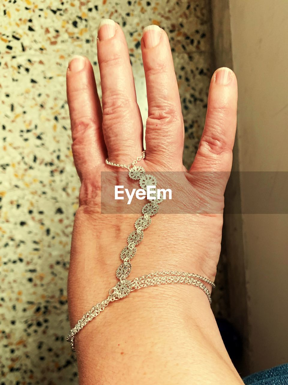human hand, hand, human body part, one person, jewelry, real people, indoors, close-up, body part, high angle view, adult, women, bracelet, finger, human finger, showing, lifestyles, personal perspective, day