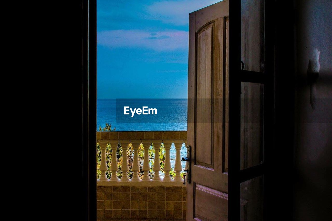sea, horizon over water, window, no people, water, sky, indoors, nature, day, scenics, architecture, beauty in nature, close-up