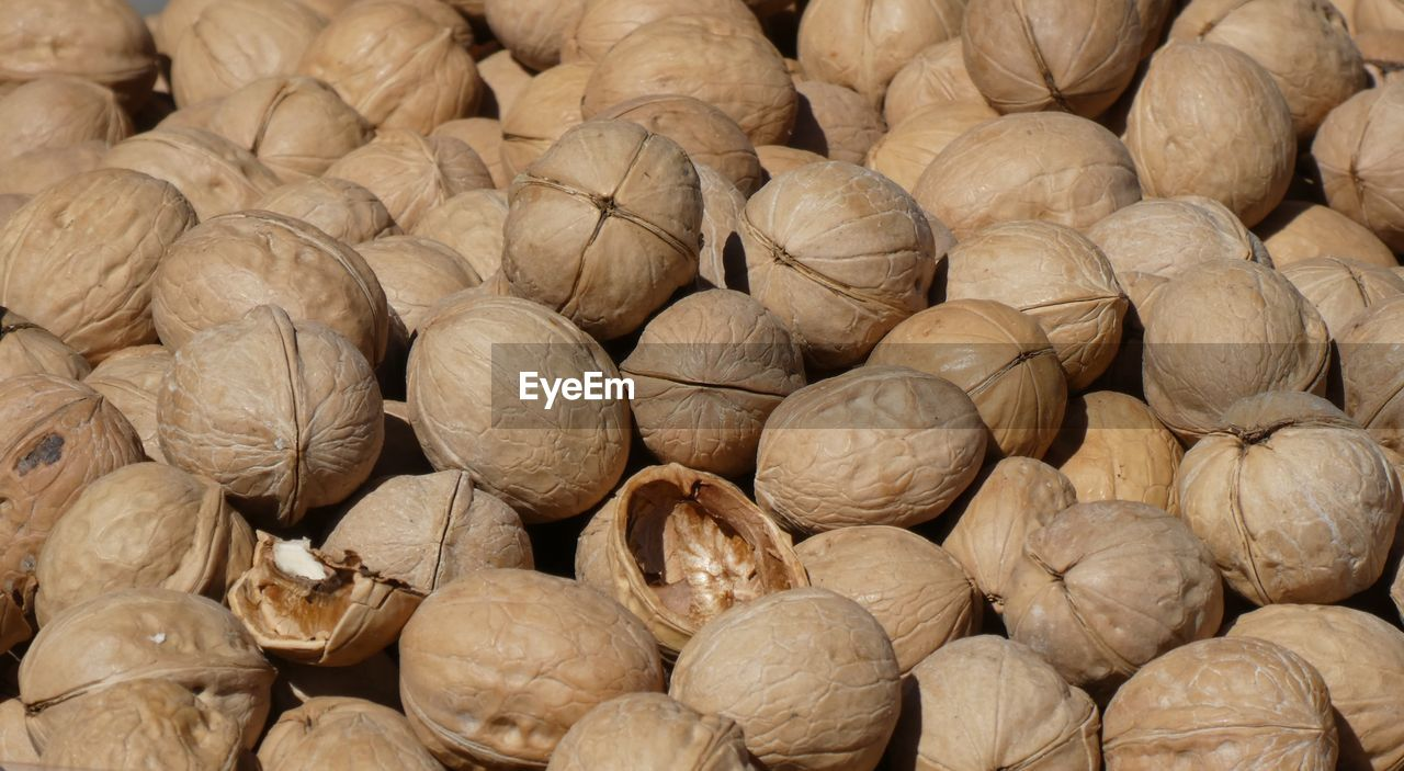 full frame, food and drink, food, large group of objects, backgrounds, wellbeing, healthy eating, freshness, abundance, no people, still life, close-up, nut, retail, walnut, nut - food, for sale, brown, market, indoors