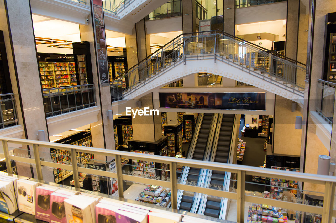 architecture, built structure, indoors, bookshelf, shelf, library, railing, balcony, book, real people, day, building exterior