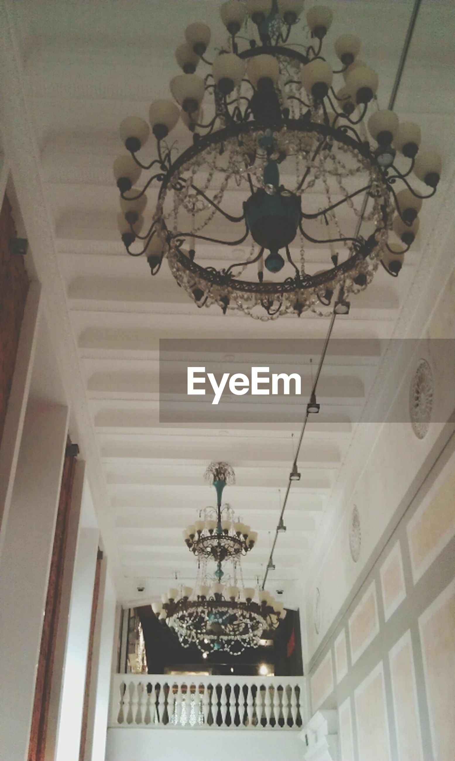 indoors, ceiling, chandelier, lighting equipment, hanging, low angle view, illuminated, decoration, architecture, electric lamp, built structure, electric light, ornate, pendant light, hanging light, design, electricity, home interior, luxury, directly below