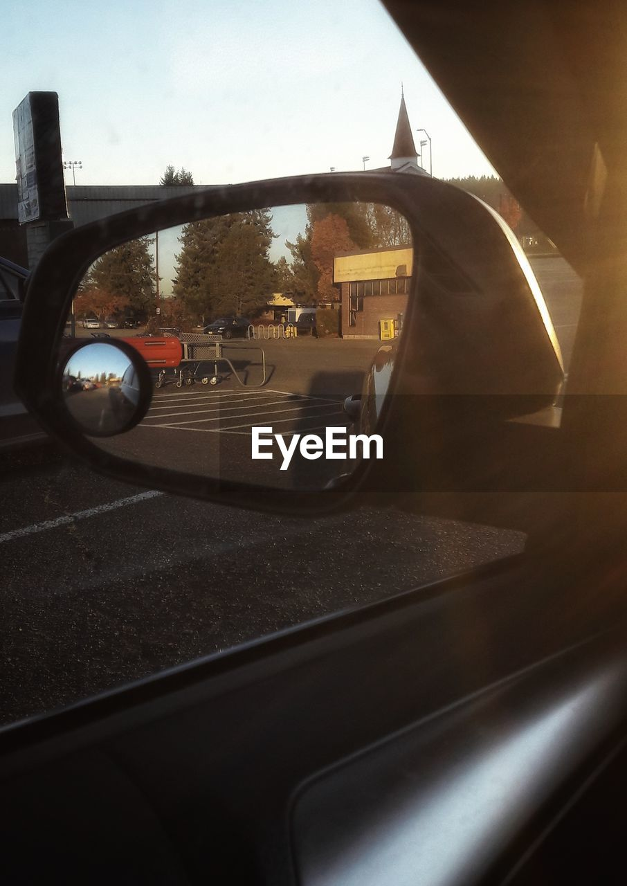 side-view mirror, transportation, reflection, mirror, car, window, vehicle mirror, sky, land vehicle, day, no people, close-up, outdoors