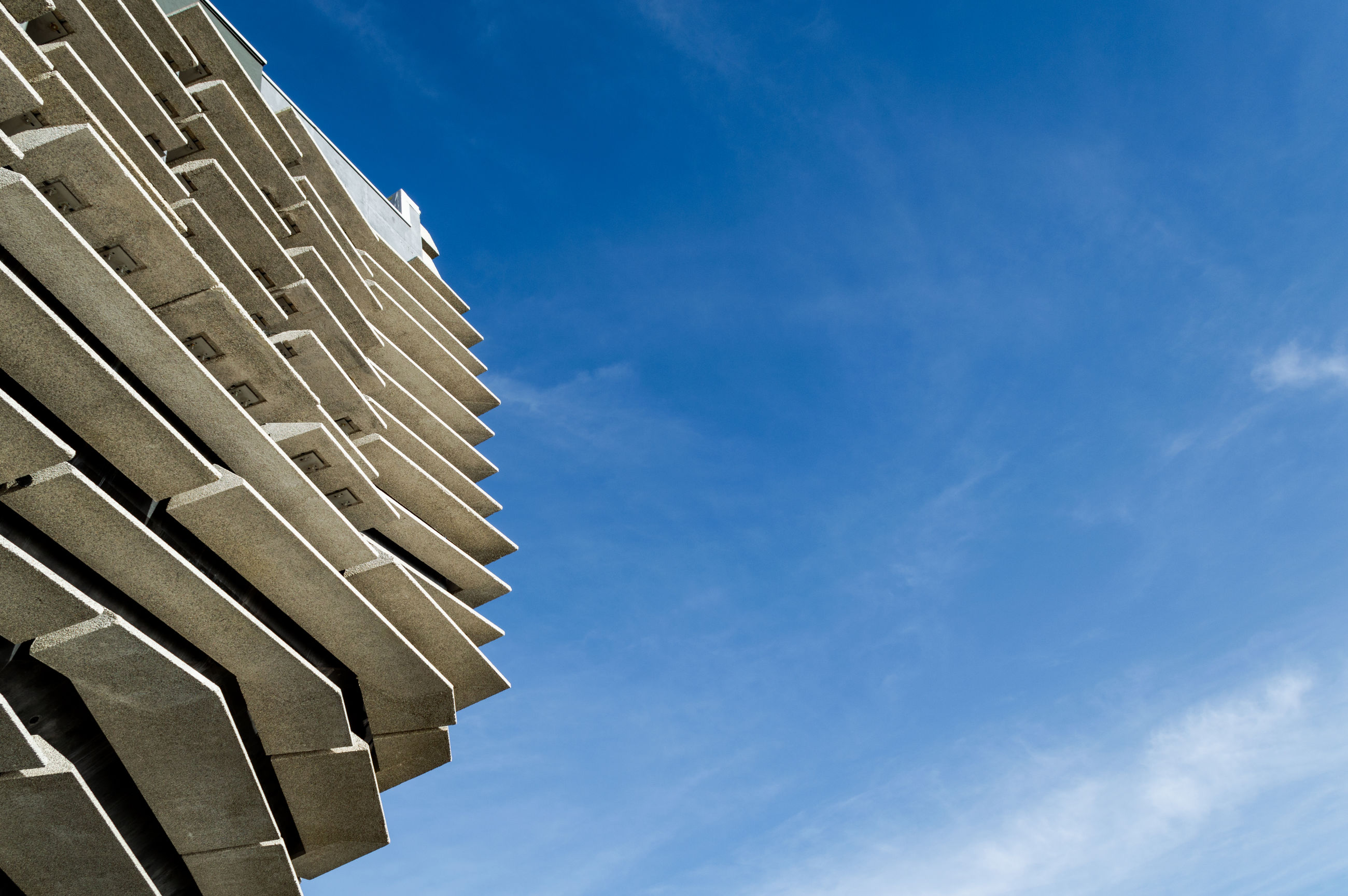 Abstract minimal architecture background photo, facade structures under blue sky at sunny day