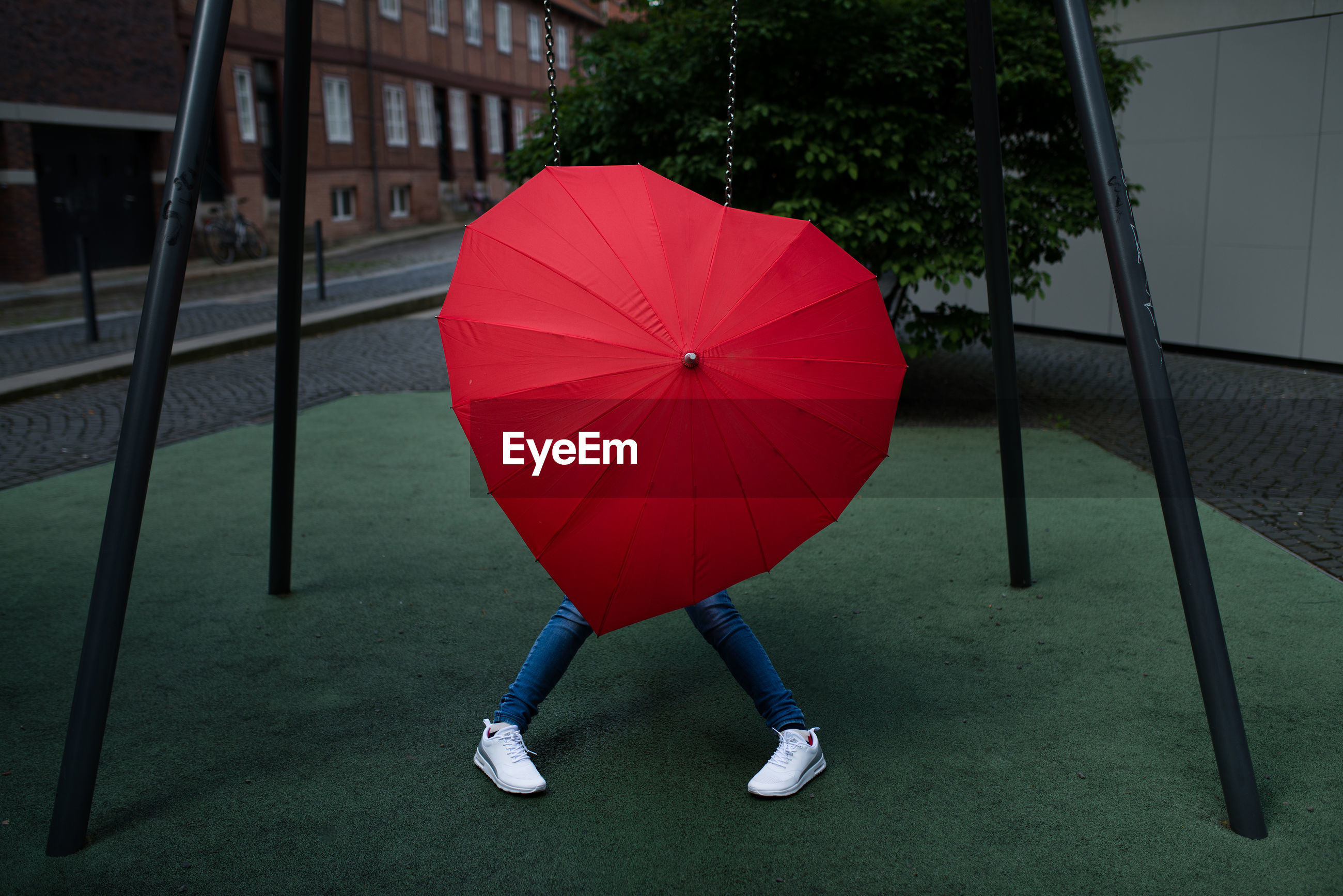 Low Section Of Person With Red Umbrella