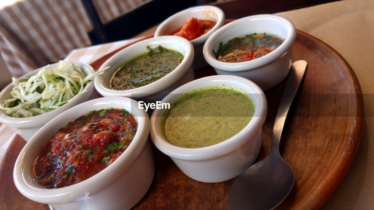 Close-Up Of Various Dips In Bowls On Table