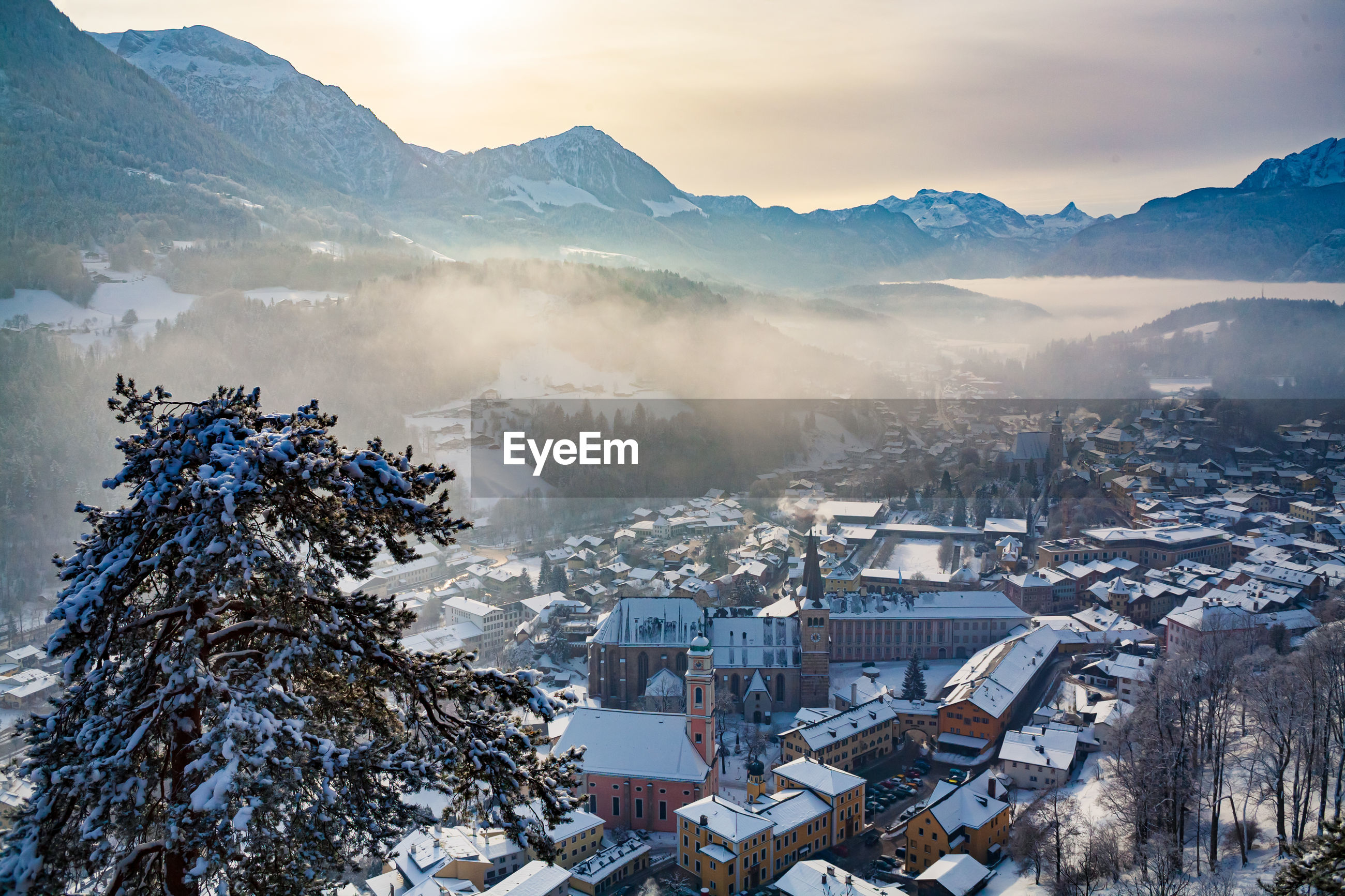 Aerial view of townscape and mountains during winter