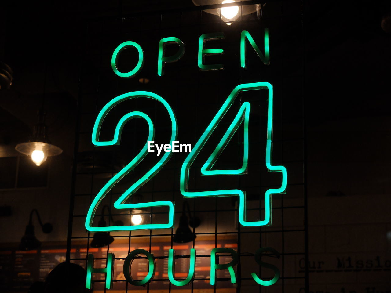 illuminated, text, western script, night, neon, glowing, communication, lighting equipment, sign, electricity, information, green color, capital letter, no people, light, number, blue, electric light, information sign, commercial sign, black background, nightlife
